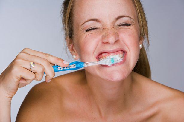 unilad-woman-brushing-her-teeth53699